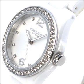 コーチ  煌びやかなラインストーンとホワイトシェルダイヤルの輝き。ラグジュアリーなレディス腕時計。 14502106