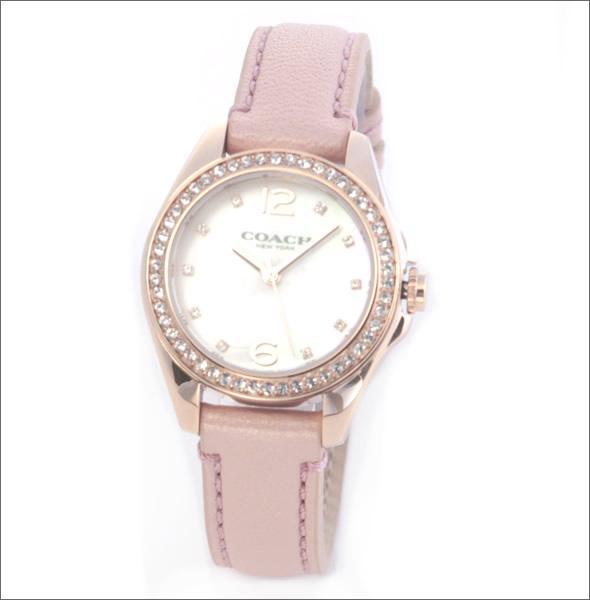 コーチ  煌びやかなラインストーンとホワイトシェルダイヤルの輝き。ラグジュアリーなレディス腕時計。 14502176