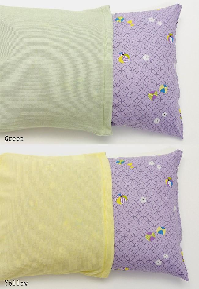色の濃い枕にカバーを被せた場合の透け感(グリーン/イエロー)